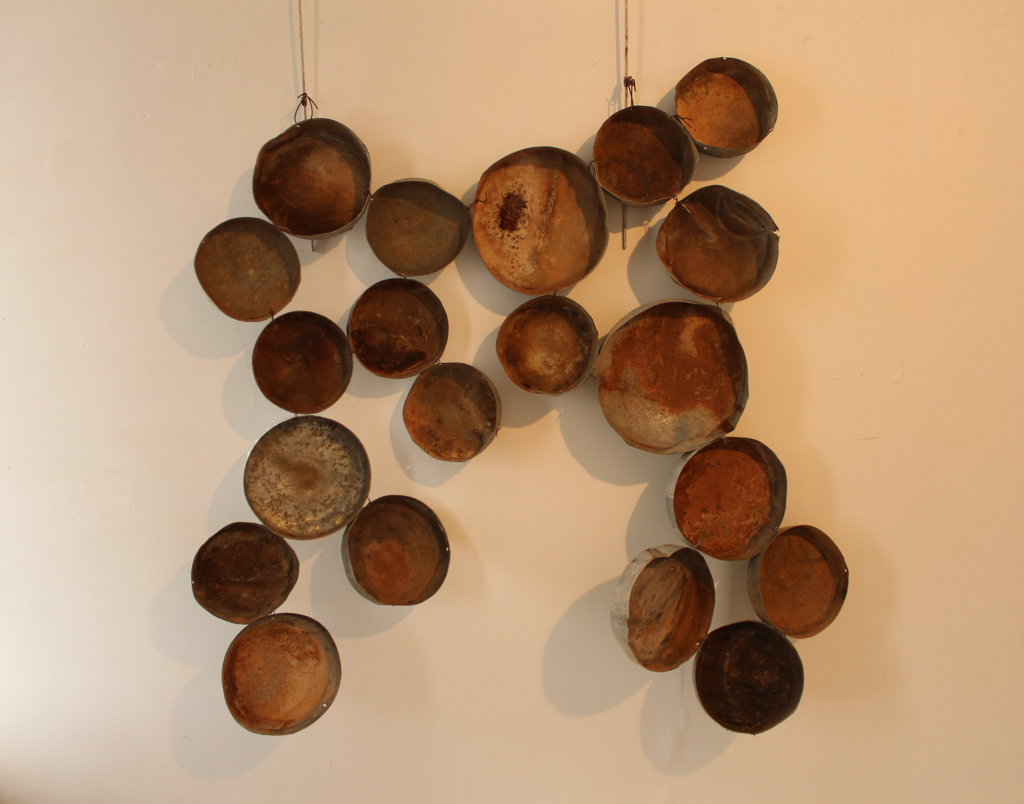 Miles Allen-Poles apart (2104) Metal caps. 160x150cm