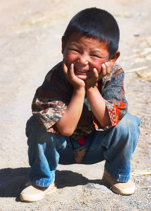 Funny Face. Little Boy in Tebetan village