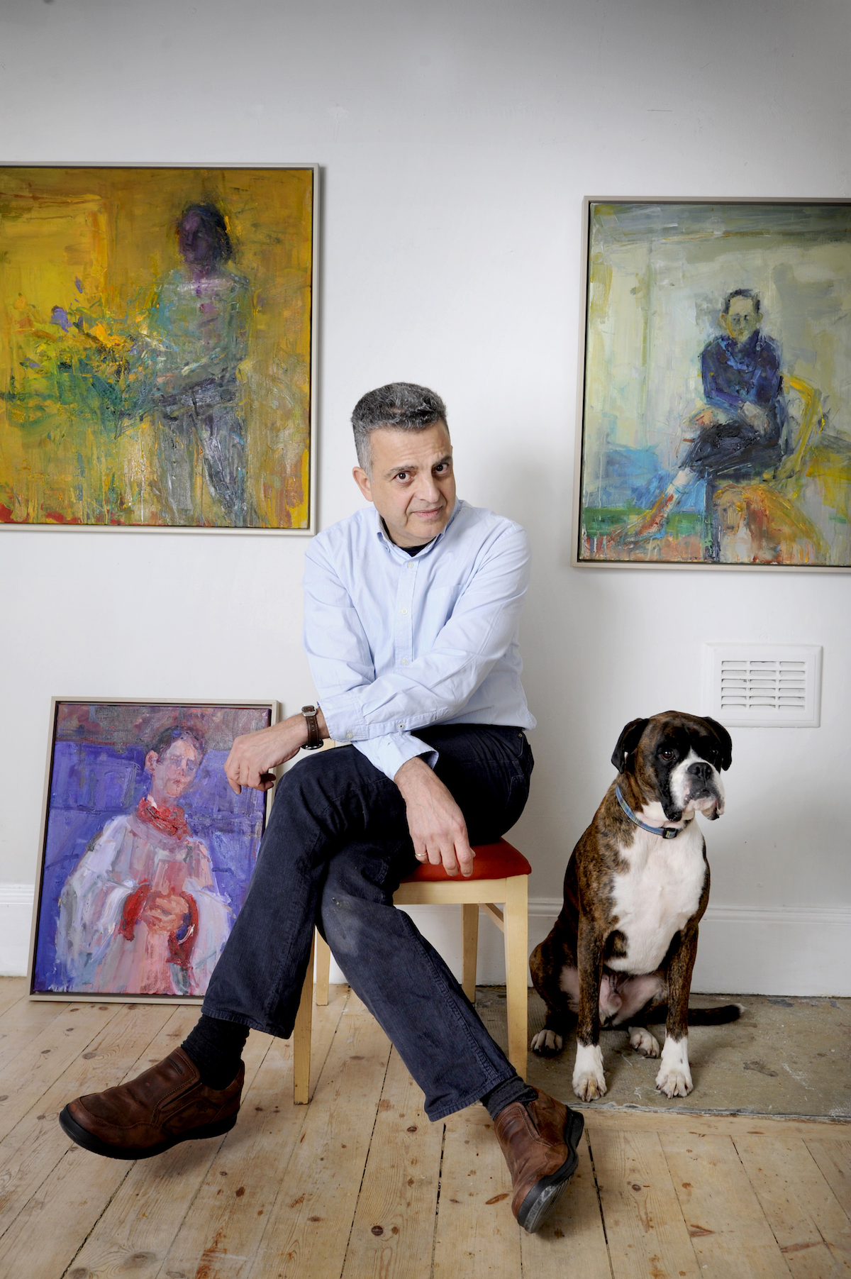 "FREE PICTURE: Artist Henry Jabber Exhibition at Union Gallery, Edinburgh, 03/03/2017: Artist Henry Jabbour (correct) at his Union Gallery exhibition of paintings, Edinburgh. Pictured with Dennis the galery mascot / dog, and Henry's paintings including ""Seated Man With Dog"" (top right). Henry left a successful career as a research scientist to train as a painter is to have his first solo exhibition, opening in Edinburgh's Union Gallery on Saturday (4th March 2017, and until 1st April 2017). Henry Jabbour, who worked for nearly 20 years based at the Medical School at Edinburgh University, left his job in medical research to train as an artist. Henry, who was born in Lebanon, worked for the Medical Research Council in Edinburgh before quitting to paint full-time in 2010. He said: ""For many years, I was working as a scientist and painting every moment I could in my spare time. Bit by bit, my passion for art outgrew my passion for the science. More information from: Susan Mansfield - PR consultant for the Union Gallery - 07803 620 038 - wordsmansfield@gmail.com Photography for Union Gallery from: Colin Hattersley Photography - www.colinhattersley.com - cphattersley@gmail.com - 07974 957 388. Free FIRST USE (ONLY) picture. Photography from: Colin Hattersley Photography - colinhattersley@btinternet.com - www.colinhattersley.com - 07974 957 388"